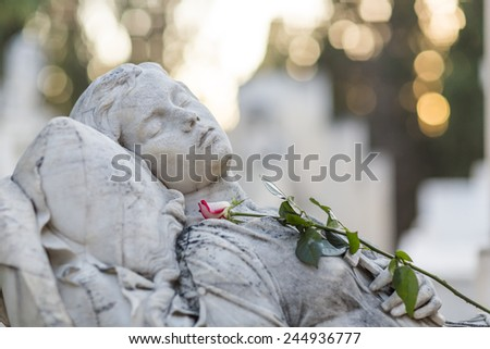 Sleeping Female Figure sculpture - stock photo