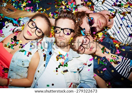 Sleeping friends lying on the floor in nightclub - stock photo