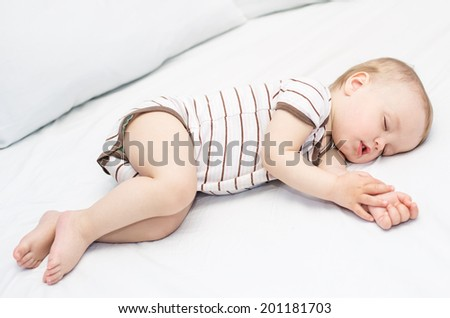 sleeping  funny baby boy on a white background - stock photo
