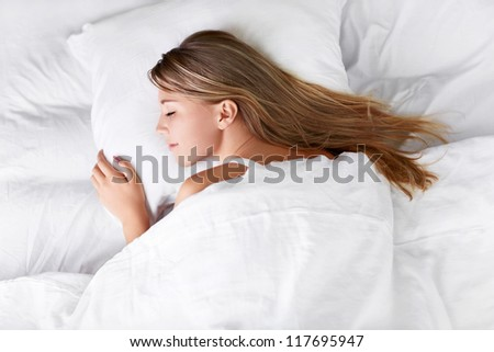 Sleeping girl in bed - stock photo