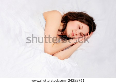 sleeping girl in bed with white pillows - stock photo