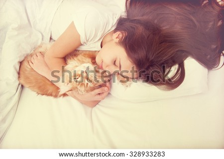 Sleeping girl with cat in retro style - stock photo