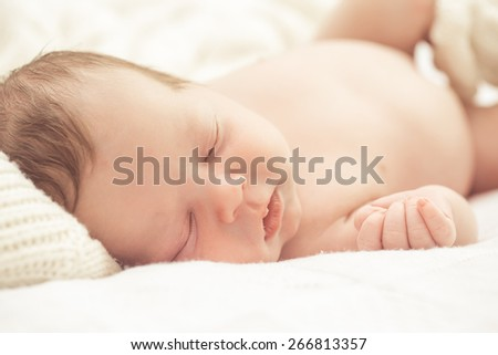 Sleeping infant boy - stock photo