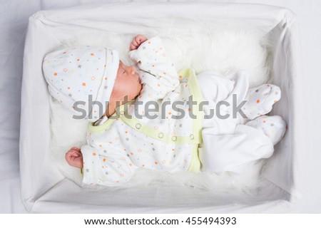 Sleeping newborn baby  - stock photo