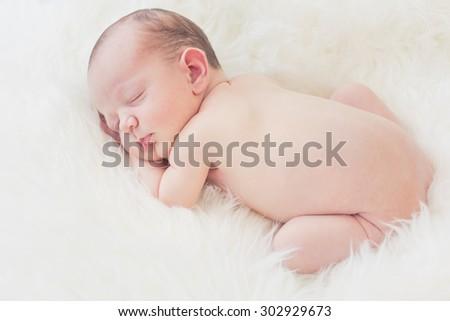 Sleeping newborn baby boy - stock photo