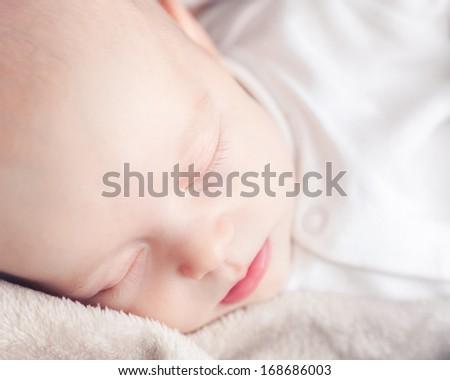 sleeping newborn baby, close up  - stock photo