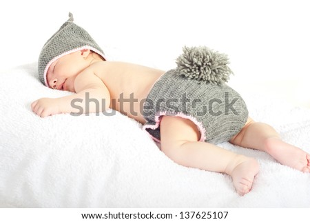 Sleeping newborn baby in knitted bunny costume isolated on white background - stock photo