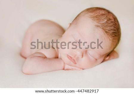 sleeping newborn baby on a blanket. close up portrait - stock photo