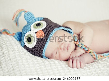 Sleeping Newborn Baby with hat - stock photo