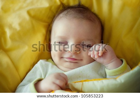 sleeping smiling newborn baby - stock photo