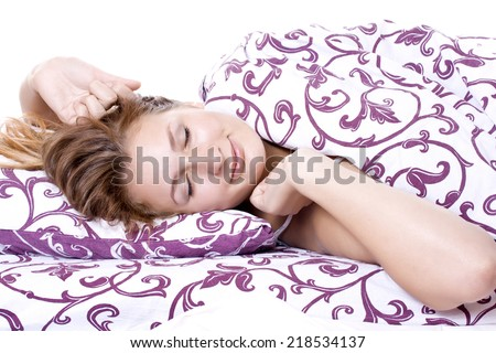 Sleeping woman stretches in a dream, a sweet dream - stock photo