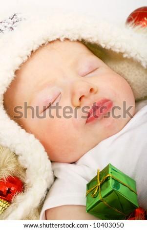 Sleepy baby with gifts - stock photo