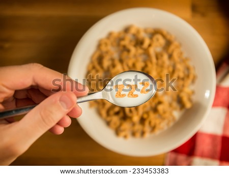 Sleepy Breakfast Cereal with Spoon - stock photo