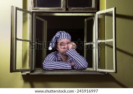 sleepy man in the window - stock photo