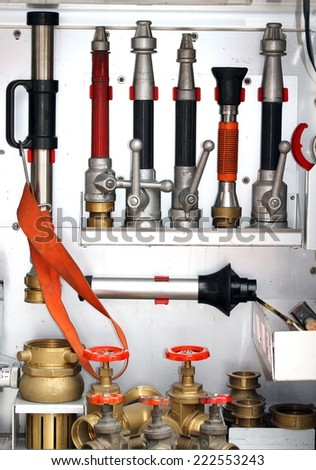 Sleeve valves and fire lances of trucks of firefighters during a fire drill - stock photo
