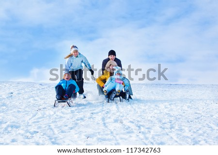 Sleigh riding leisure time in winter - stock photo