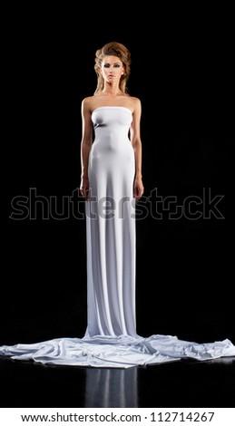 Slender girl in long white dress - stock photo