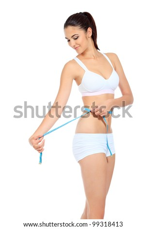 Slender woman measuring her waist. Diet, healthy lifestyle. - stock photo