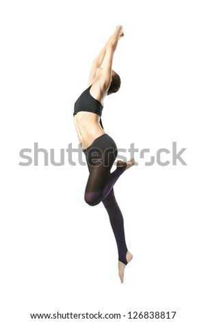 slender young gymnast on a white background - stock photo