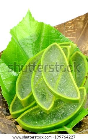 Slice Aloe Vera (Aloe barbadensis  Mill.,Star cactus, Aloe, Aloin, Jafferabad or Barbados) a very useful herbal medicine for skin treatment and use in spa for skin care. - stock photo