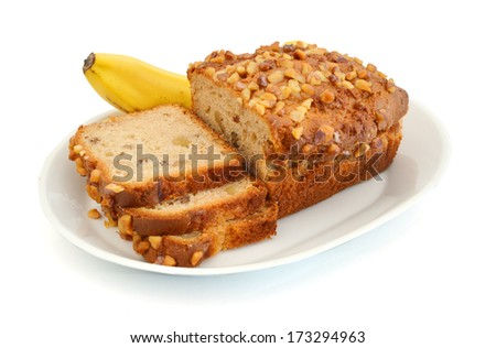 Slice banana bread and banana in plate on white  - stock photo