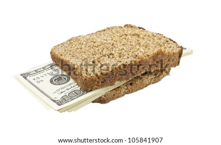 Slice bread with money inside isolated on white background - stock photo