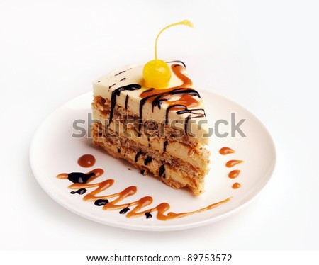Slice of a sweet cake on a plate with cherry. - stock photo