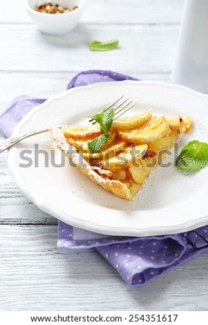 slice of apple tarte with cinnamon, mint, food - stock photo
