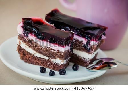 Slice of blueberry pie with yogurt - stock photo