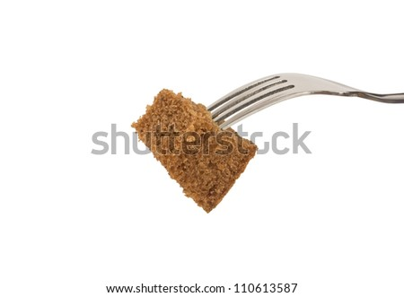 Slice of bread on a fork isolated - stock photo