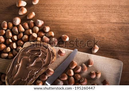 Slice of bread with chocolate cream 2 - stock photo