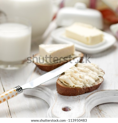 Slice of bread with cream cheese for breakfast - stock photo
