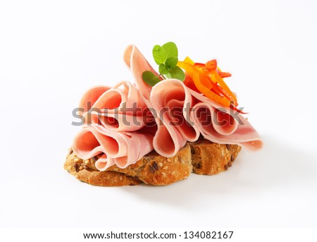 slice of bread with fresh ham and pepper - stock photo
