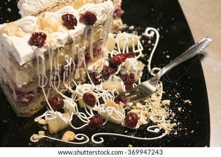 Slice of Delicious Cake on Ancient table - stock photo