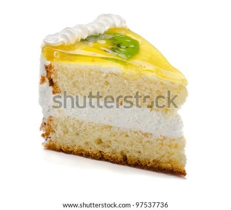 Slice of delicious fruit kiwi cake isolated on white - stock photo