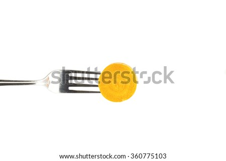 slice of fresh carrots on a fork on a white background - stock photo