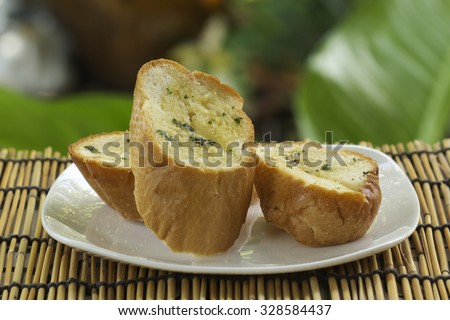 Slice of Garlic bread on the plate  - stock photo