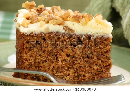 slice of home made carrot cake with butter cream icing - stock photo