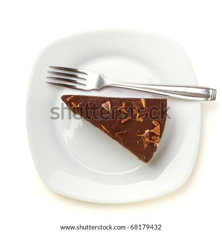Slice of homemade Chocolate Cake isolated on white viewed from above. - stock photo