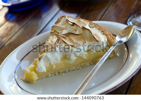 Slice of Lemon Meringue Tart - stock photo