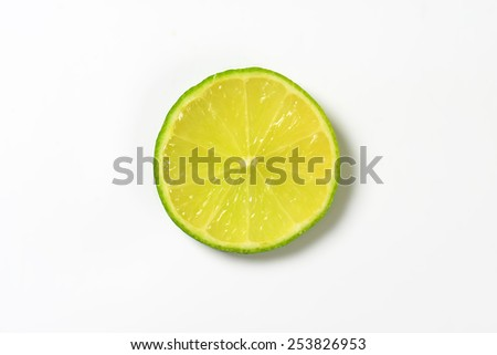 slice of lime on white background - stock photo