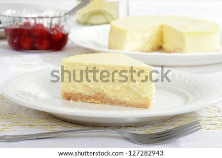 Slice of new york style cheesecake - stock photo