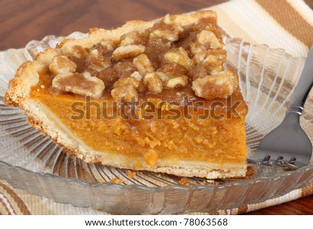 Slice of pumpkin pie on a plate - stock photo
