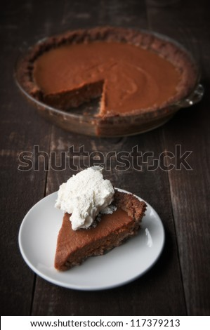 Slice of pumpkin pie with whipped cream - stock photo