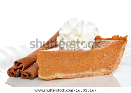 slice of pumpkin pie with whipped topping and cinnamon sticks isolated on white background - stock photo