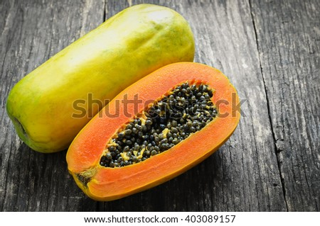 Slice of ripe papayas on wooden table with vintage and vignette, Healthy fruit - stock photo