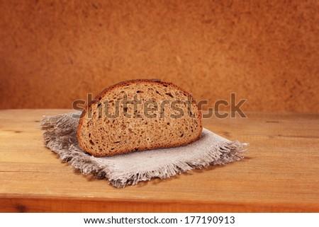 slice of rye bread on napkin - stock photo