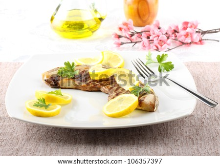 Slice tuna with lemon on complex background - stock photo