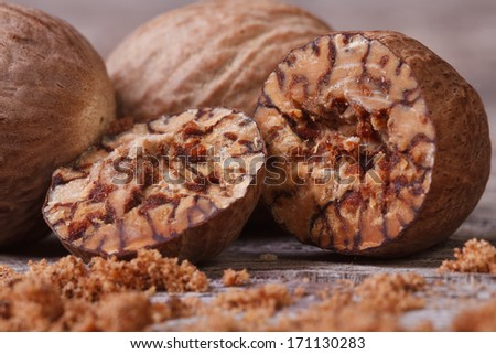 sliced ??and grated nutmeg on an old wooden table. macro - stock photo
