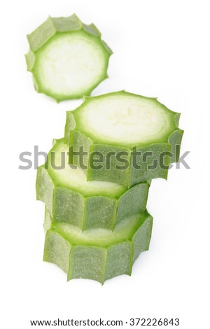 sliced angled loofah on white background - stock photo